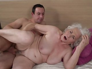 Grey-haired female gets the brush hairy cunt fucked by younger boy