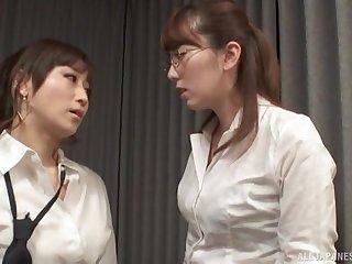 Nerdy Japanese lesbian Yuu Kawakami fingers the brush friend's pussy