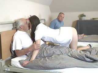 Young nurse Nana Garnet is sucking hard dicks be expeditious for two pensioners