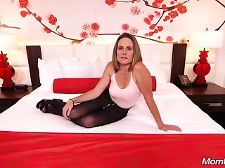 Skinny brunette milf with saggy tits, Judith, is riding a changeless white flannel be expeditious for a camera