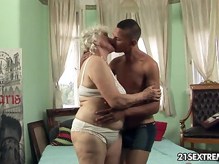 Granny Norma takes young boy's hard cock